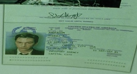 Close up of Neo's passport in The Matrix