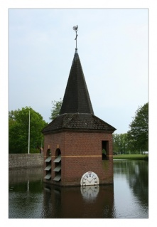 Church tower in pond
